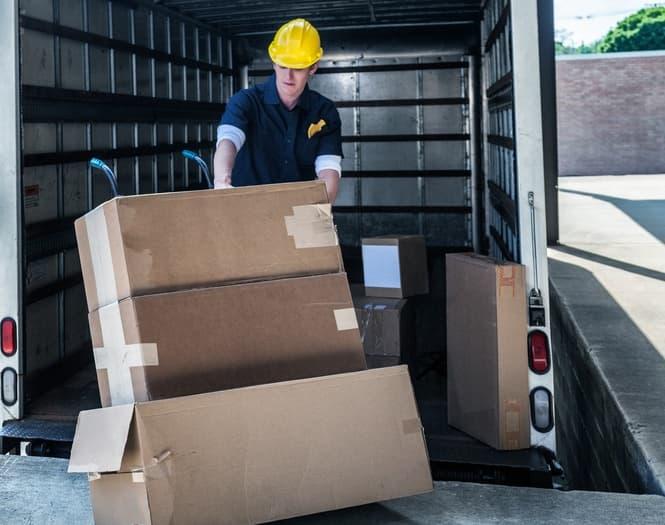 Man moving cardboard boxes