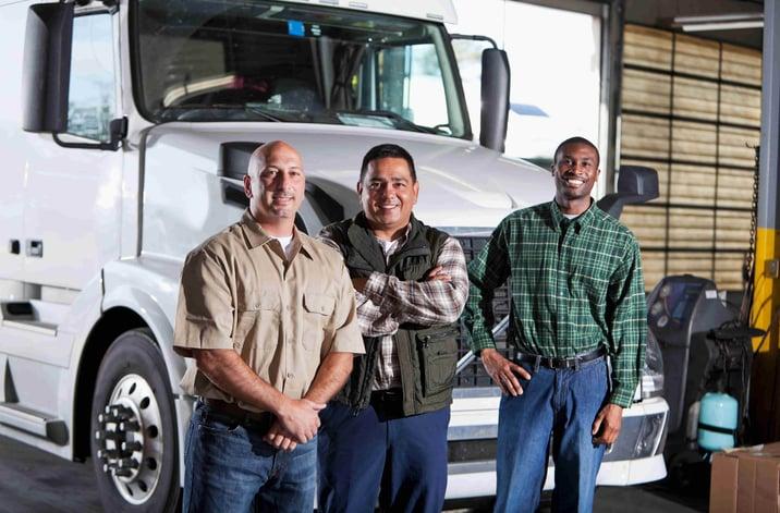 Men standing in front of a truck