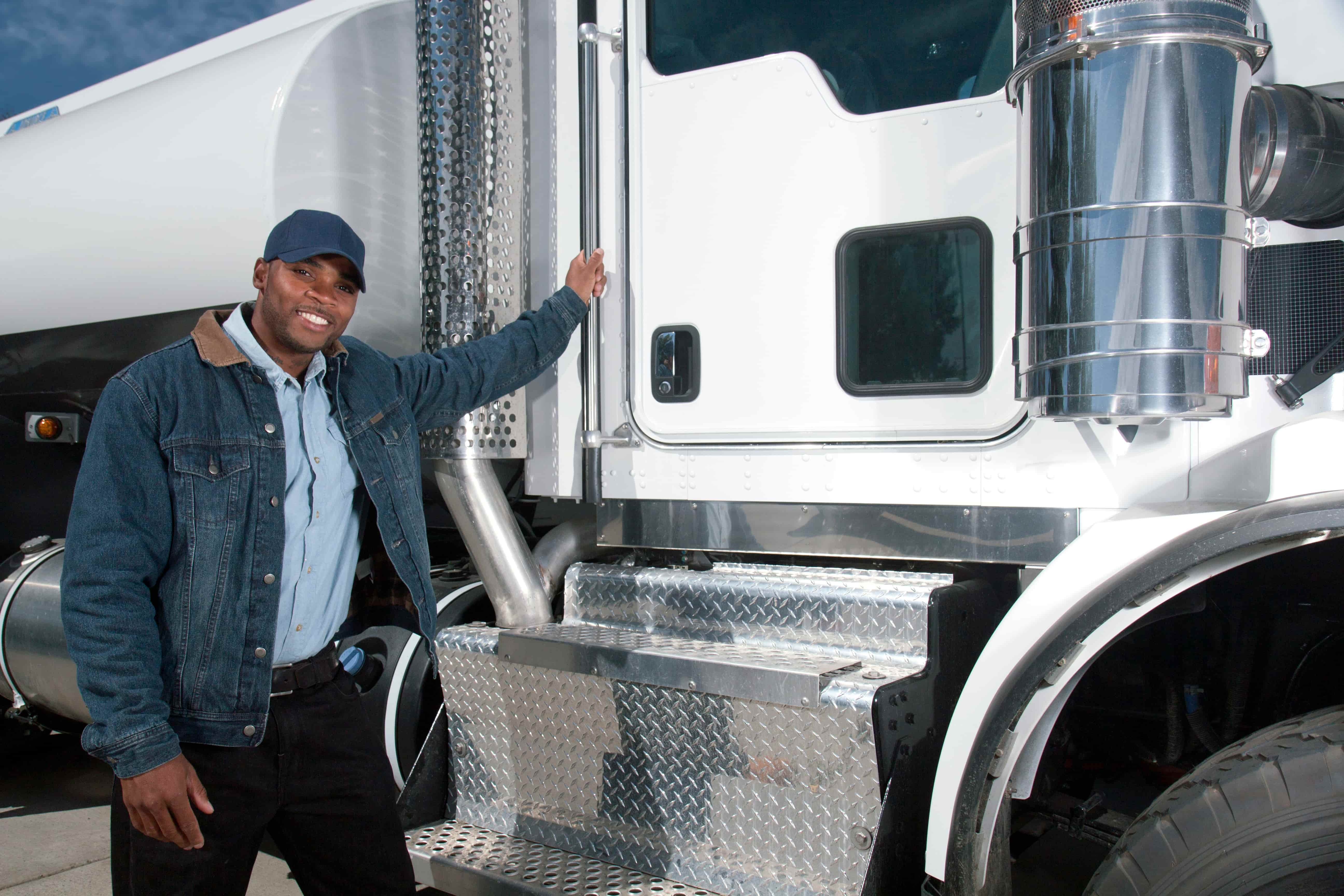 Man standing next to his truck