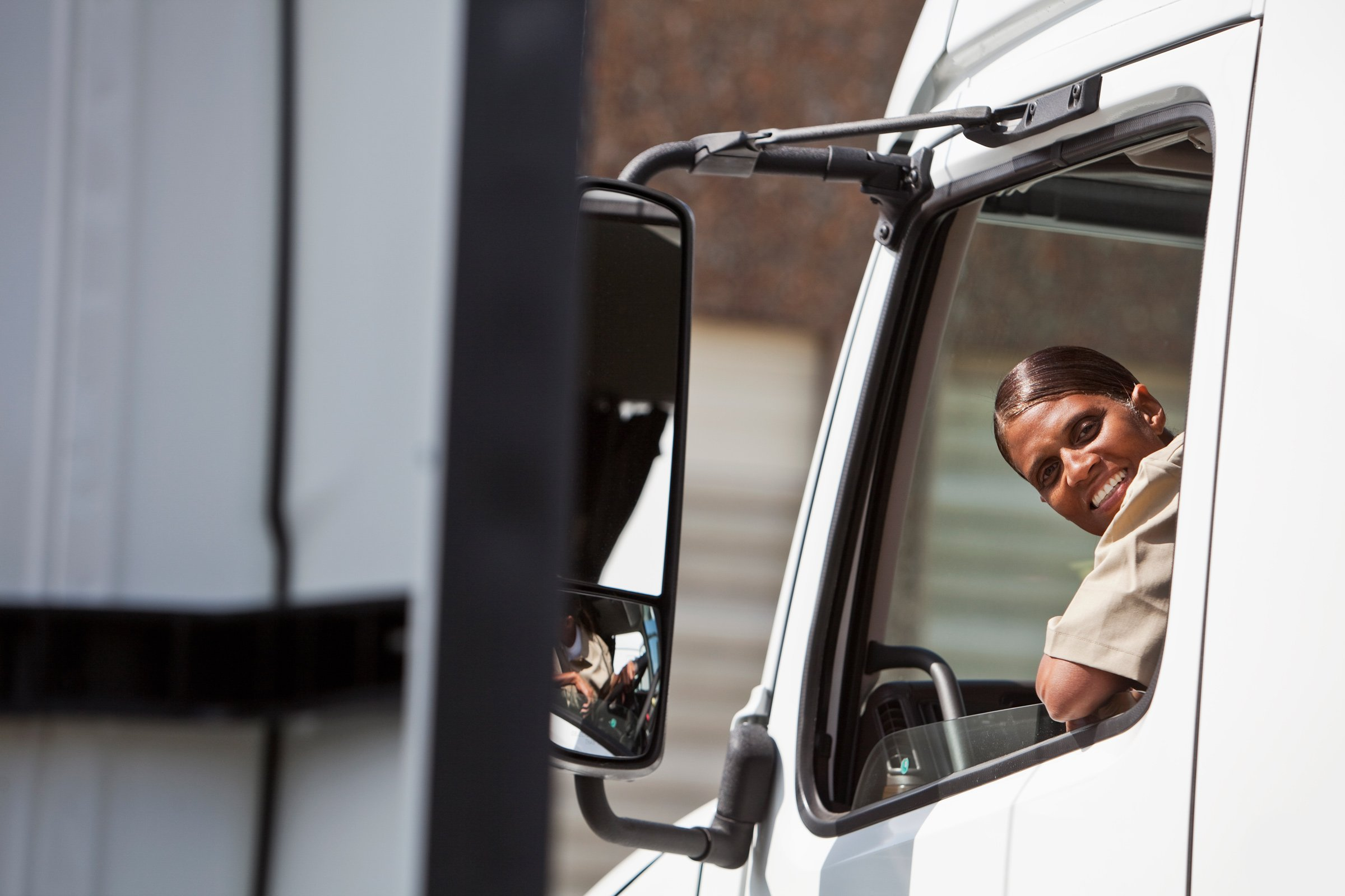 Female-Truck-Driver-Looking-Out-Window