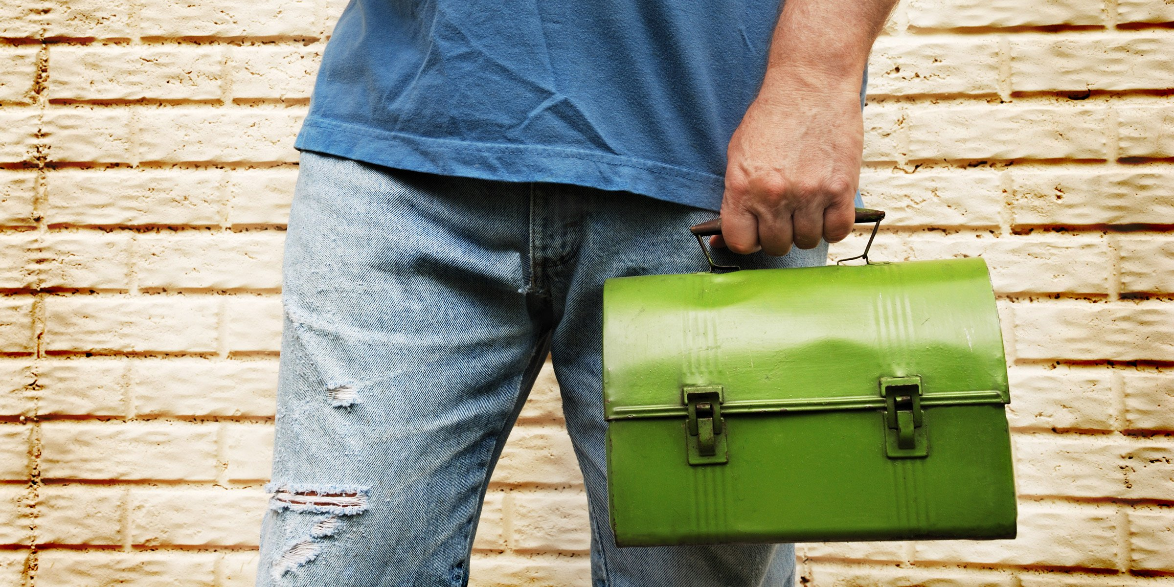 Man carrying lunch box
