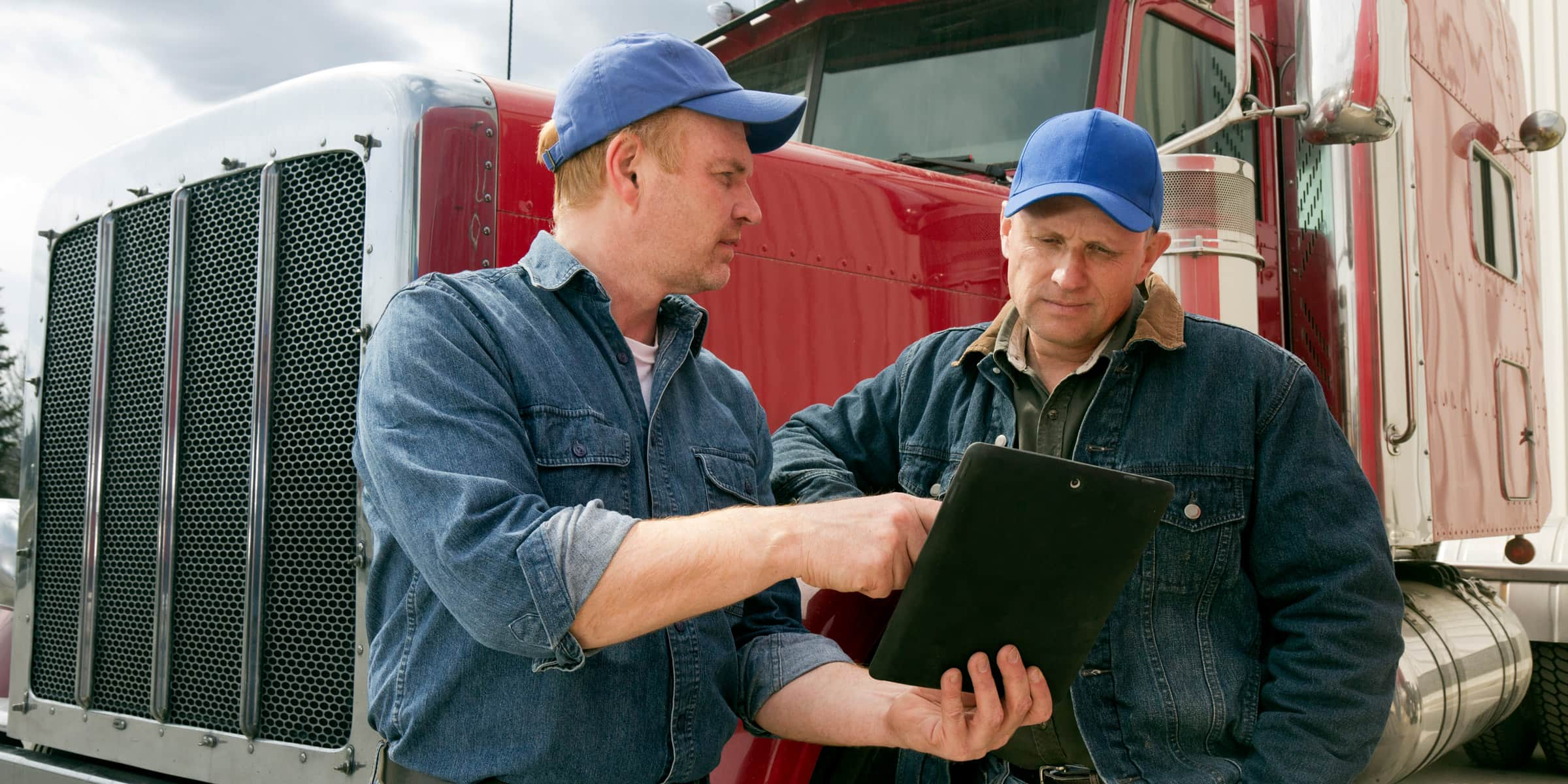 Truck drivers talking with iPad