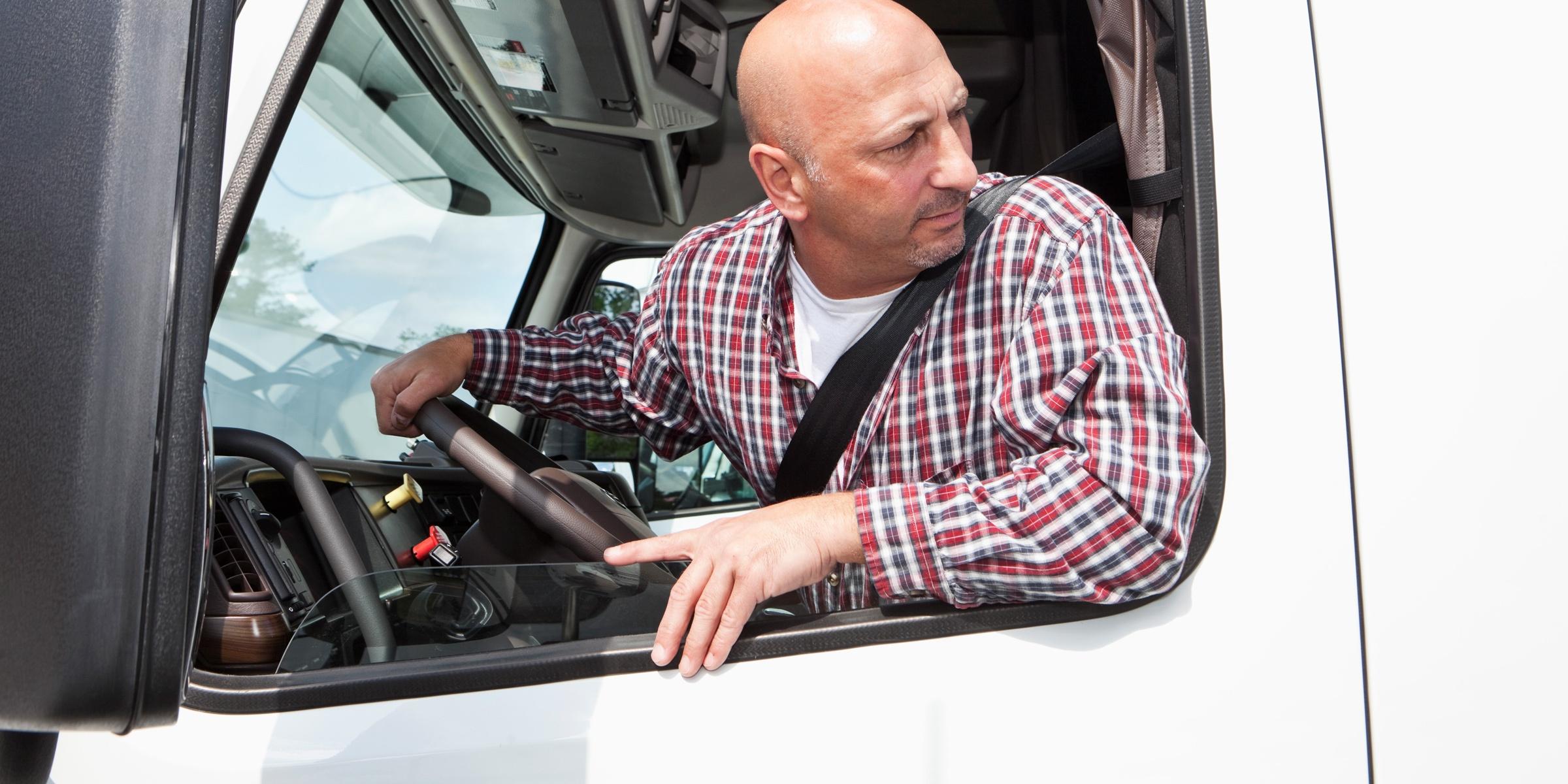 Man reversing semi truck