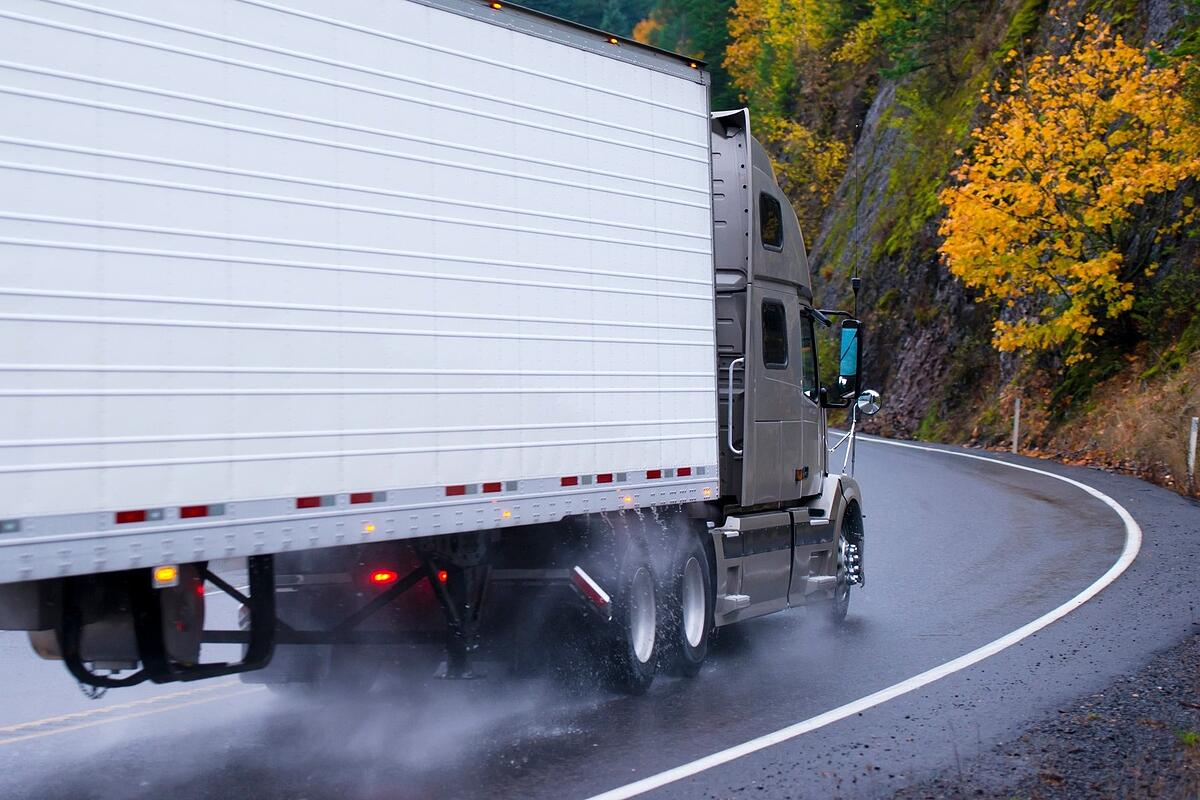 truck driving on wet road