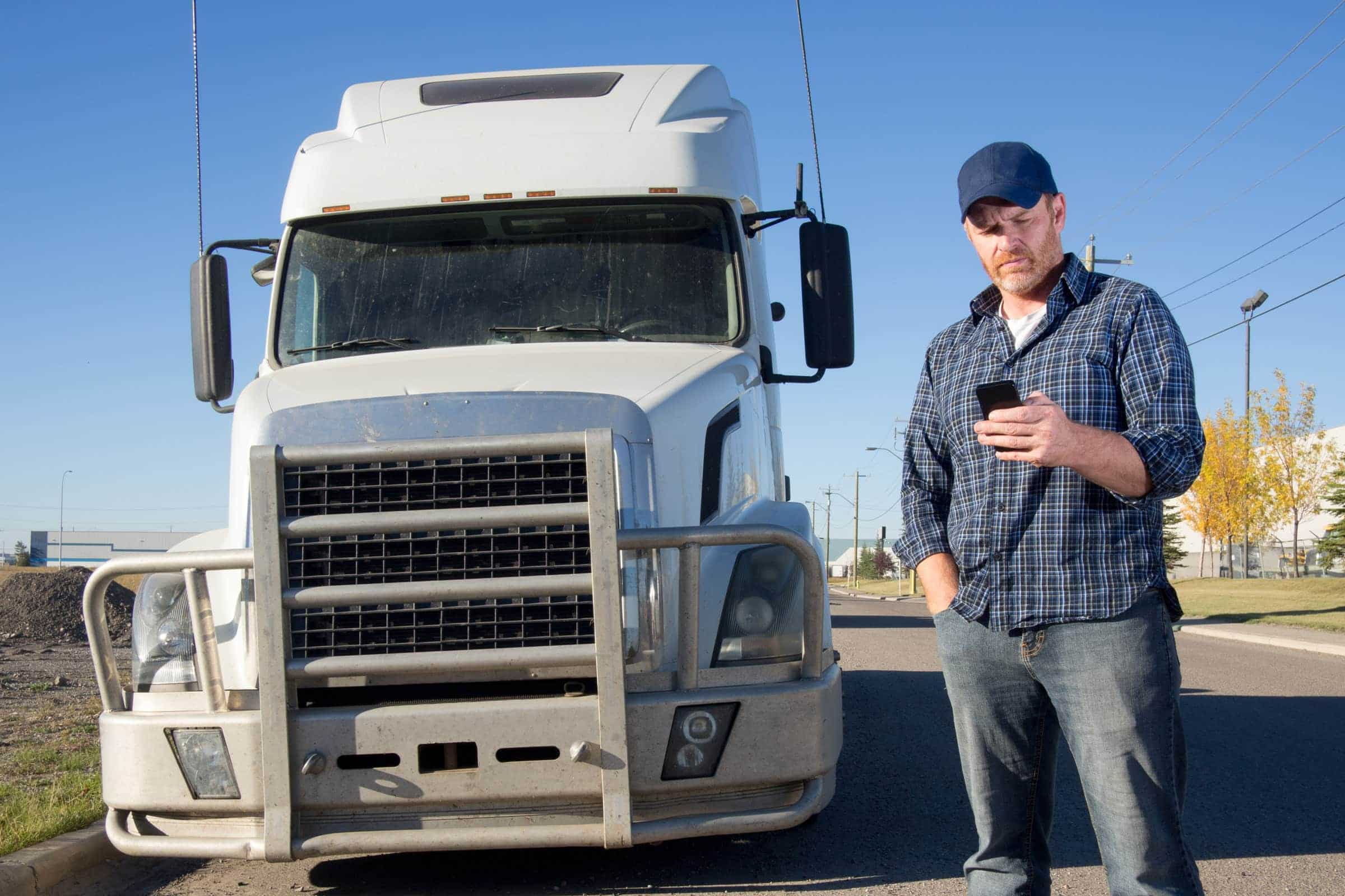 truck driver reporting accident on phone