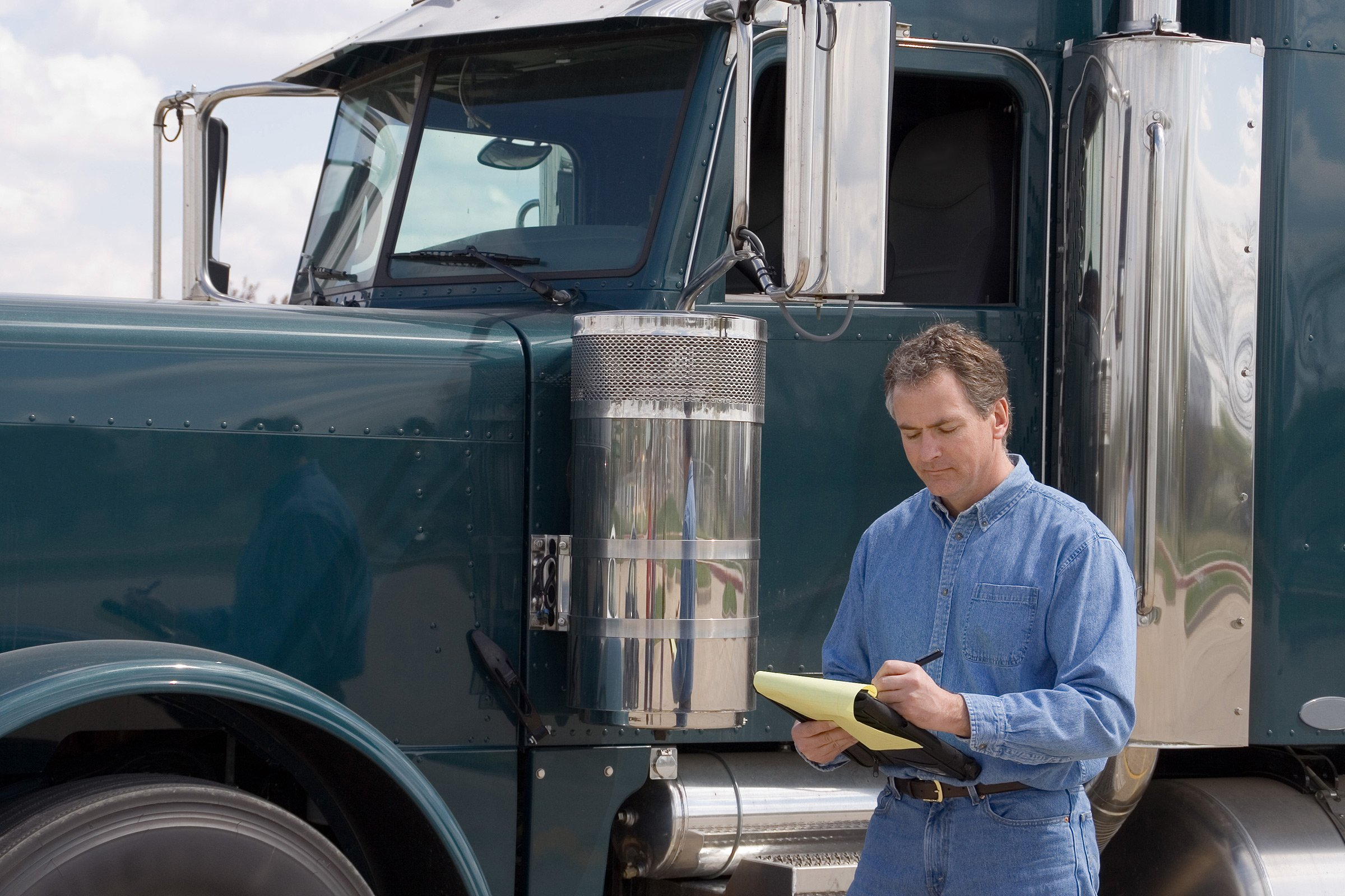 Truck Driver Writing on iPad
