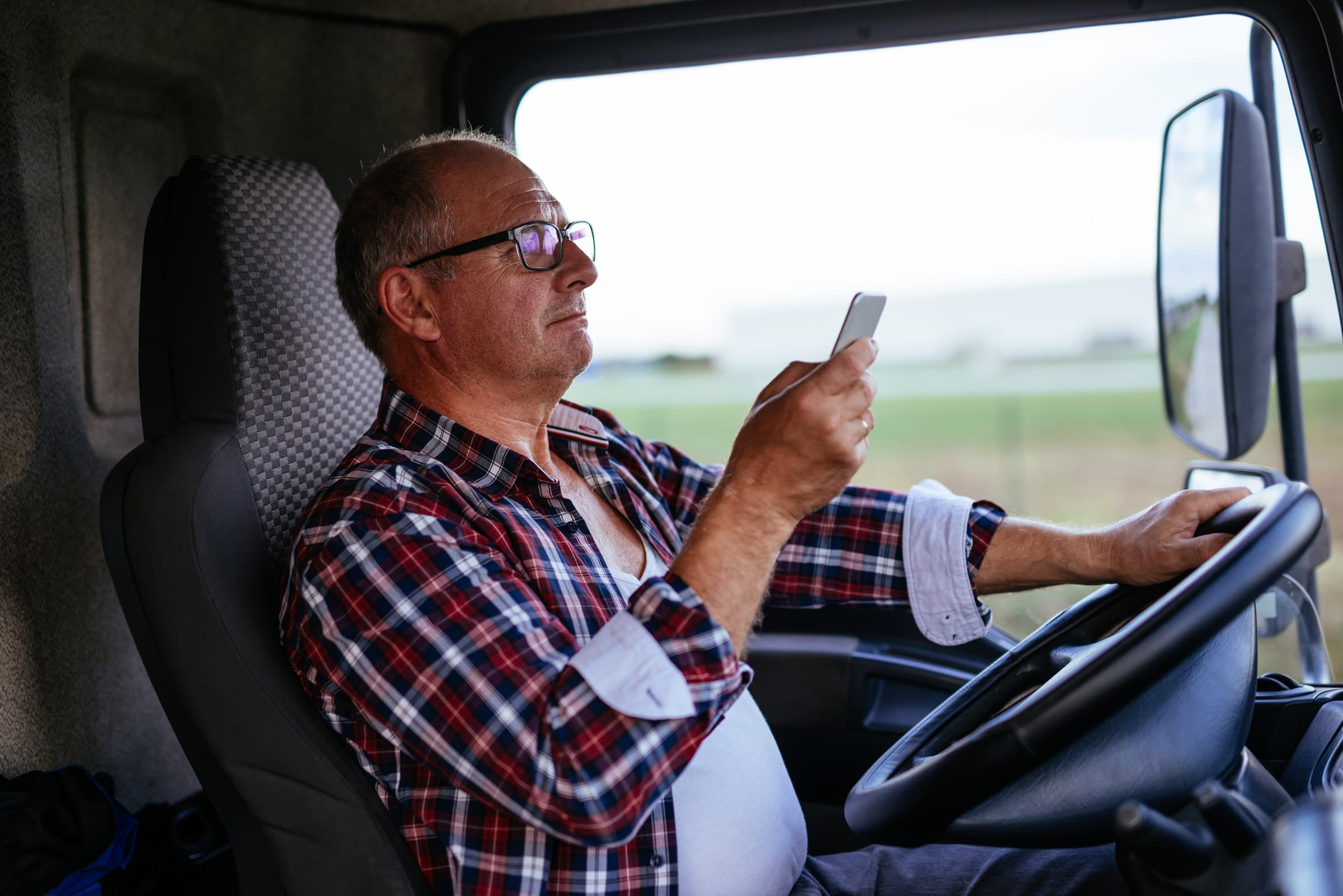 Truck-Driver-Looking-At-Phone-While-Driving