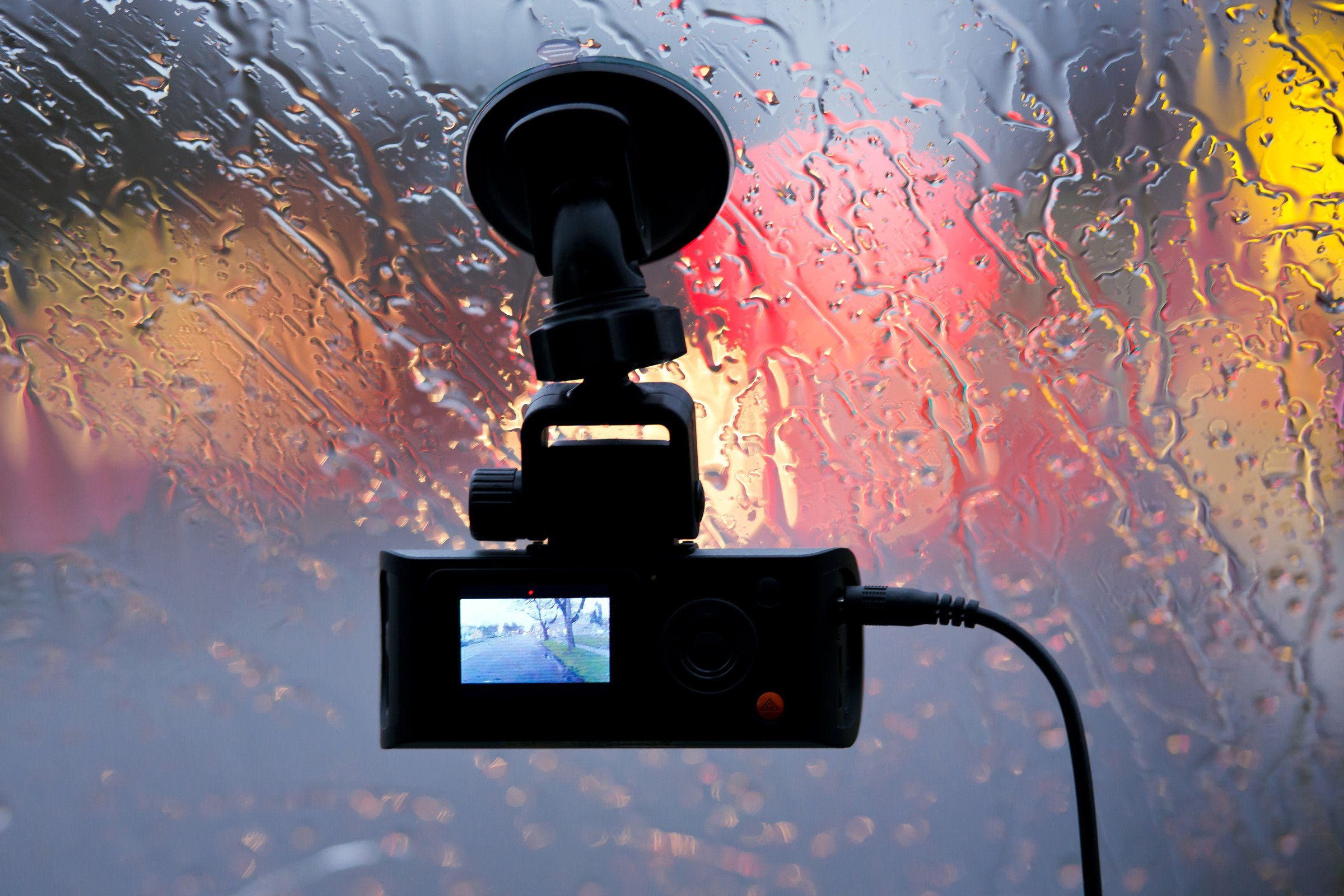 Vehicle dvr on glass of car in rain