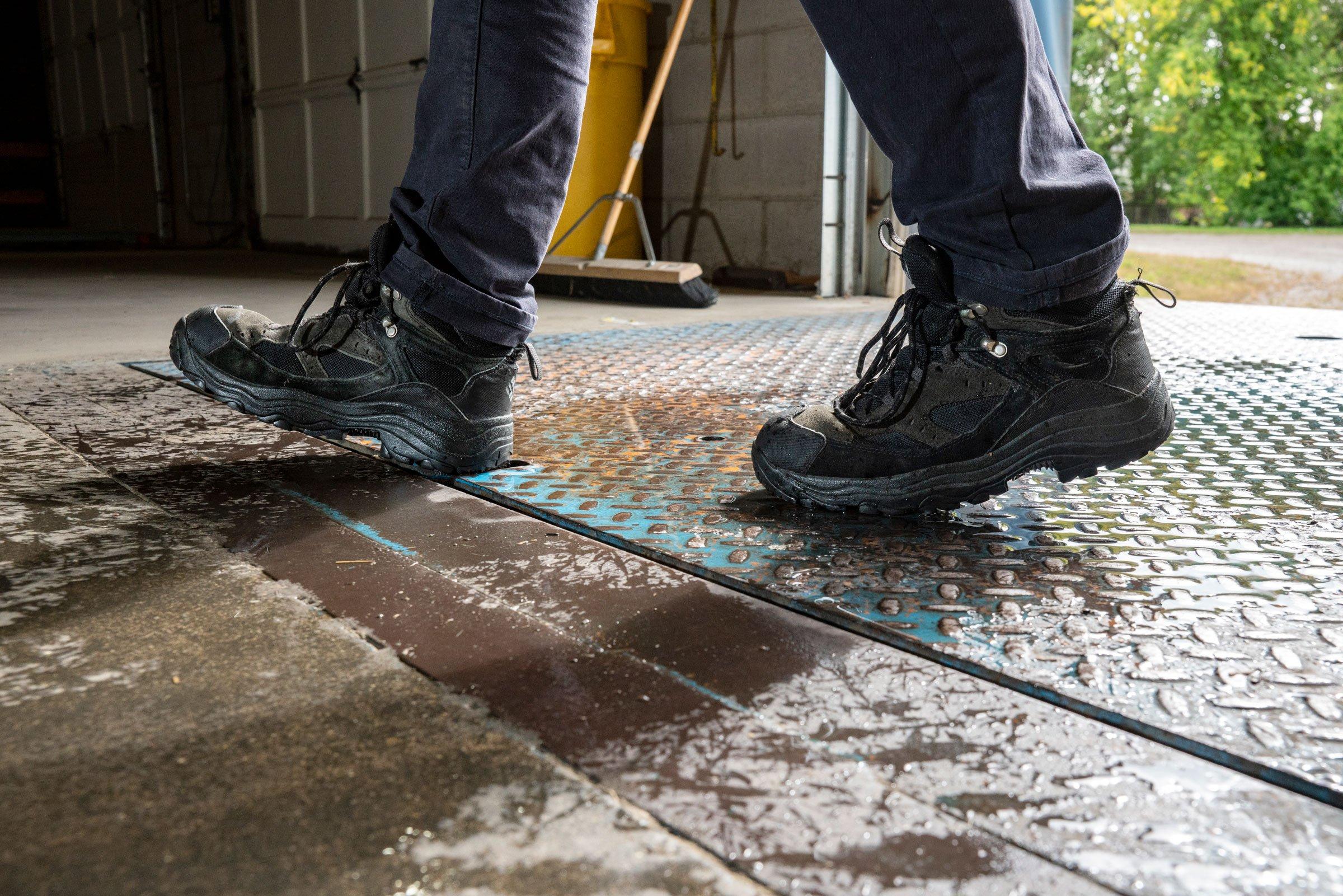 black-boots-walking-on-shop-floor